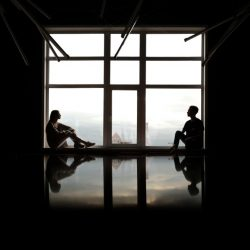 making-real-choices-sitting-on-the-window-and-looking-to-each-other-reflections-and-low-key-through-the_t20_Xvmb8G
